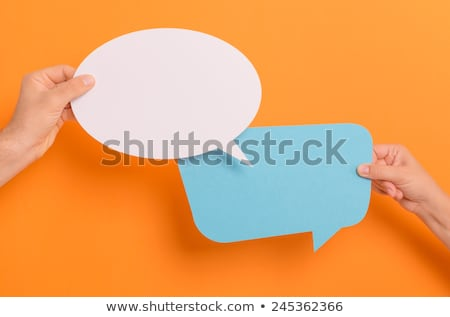 person holding orange empty speech bubble with copy space isolated on white Stock photo © LightFieldStudios