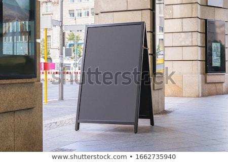 Logo Design on Chalkboard in the Office. Stock photo © tashatuvango