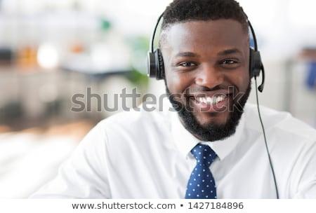 Homem fone sorridente retrato tecnologia telefone Foto stock © IS2