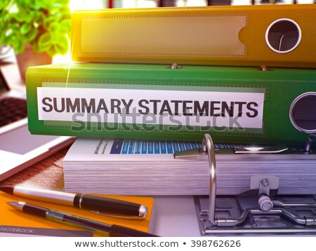 summary statements on green ring binder blurred toned image stock photo © tashatuvango