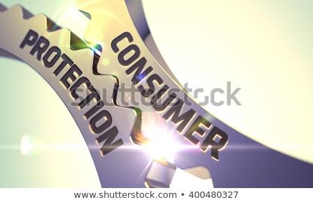Golden Metallic Cog Gears with Consumer Protection Concept. Stock photo © tashatuvango