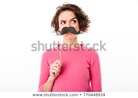 Funny woman holding fake moustache and glasses Stock photo © deandrobot