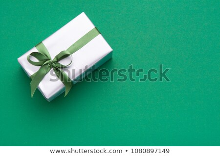 Handing a green paper to the colleague Stock photo © IS2