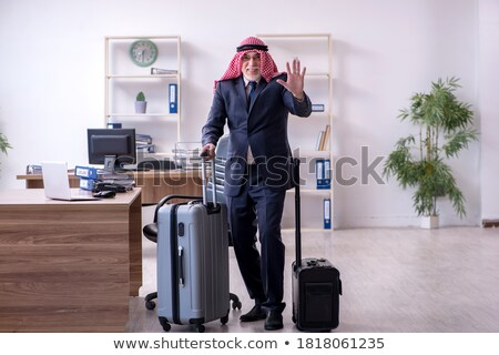 Arabic businessman with suitcase waving hand Stock photo © studioworkstock