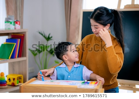 Mother with her son in a library Stock photo © Kzenon