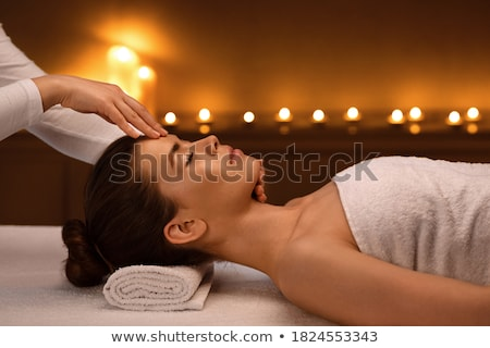woman lying on massage table stock photo © is2