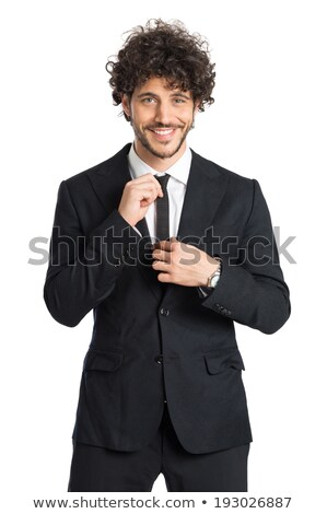 portrait of handsome young man in black tuxedo looking proud Stock photo © feedough