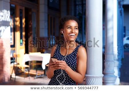 幸せ アフリカ 女性 ドレス イヤホン リスニング ストックフォト © deandrobot