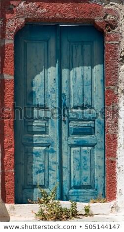 old wooden door in rural area of greece stock photo © simazoran