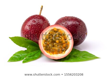 Close-up of Passion fruit in a drops of water - fresh juicy exotic fruit with tropical leaf. Stock photo © artjazz