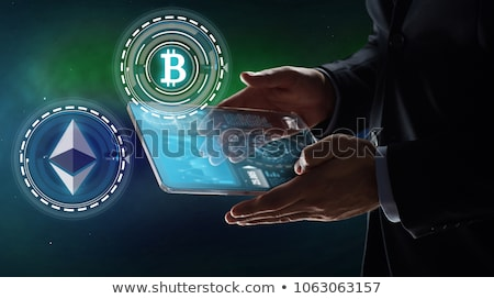 businessman with tablet pc and ethereum hologram Stock photo © dolgachov