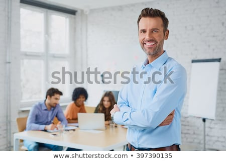 Portrait Of Happy Businessman Smiling At Camera In Coworking Office Stock photo © diego_cervo