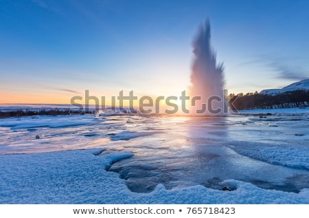 Geiser uitbarsting IJsland verbazingwekkend natuur zonsondergang Stockfoto © Kotenko