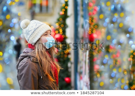 Christmas Holiday Person Buying from Street Shop Stock photo © robuart