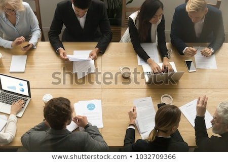 An Overhead View Of Businesspeople In Meeting Stock photo © AndreyPopov