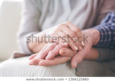 Hands of aged spouses Stock photo © pressmaster