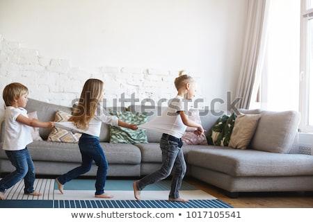 Three kids playing in living room Stock photo © colematt