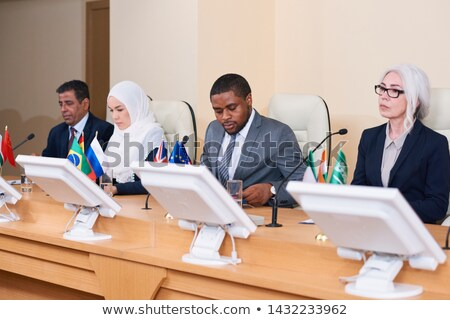 Row of contemporary young and mature intercultural politicians Stock photo © pressmaster