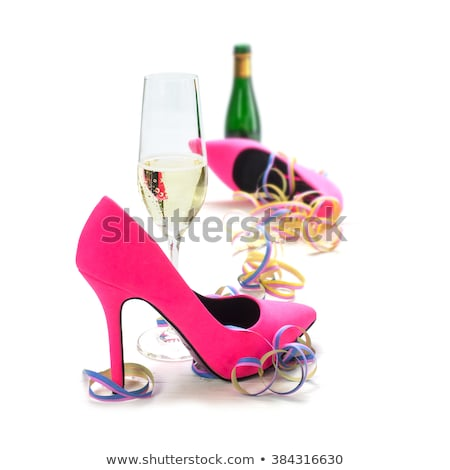 drunk woman with glass of champagne dancing lady stock photo © robuart