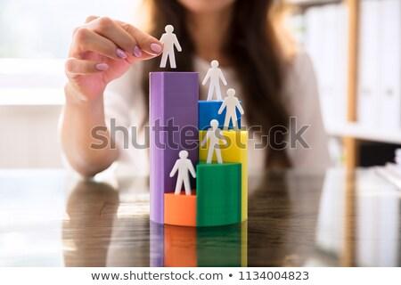 Businessperson Placing Blue Human Figure Stock photo © AndreyPopov