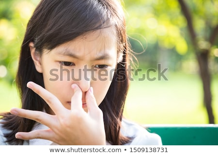 Young woman with disgust on his face pinches nose, something stinks, very bad smell in swimming pool Stock photo © galitskaya