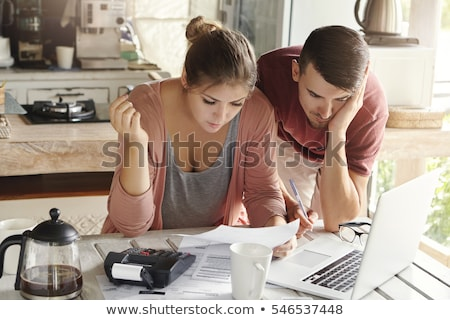Couple planning family budget expenses Stock photo © pressmaster