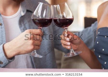 Engagé couple potable vin rouge célébration Photo stock © dolgachov