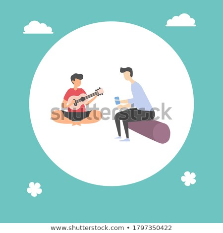 People in Park, Man Playing Guitar Sitting on Log Stock photo © robuart