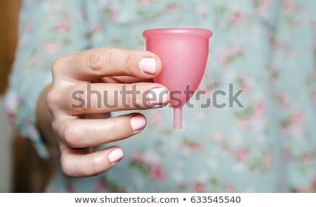 Close up of woman hand holding menstrual cup Stock photo © galitskaya