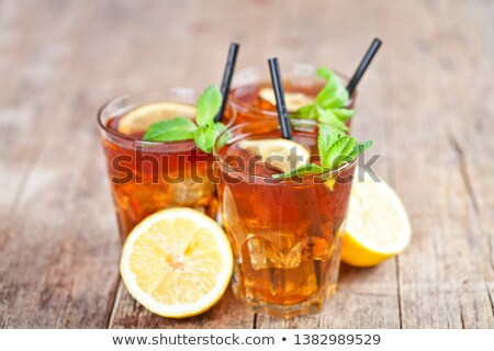 Ttree glasses of traditional iced tea with lemon, mint leaves an Stock photo © marylooo