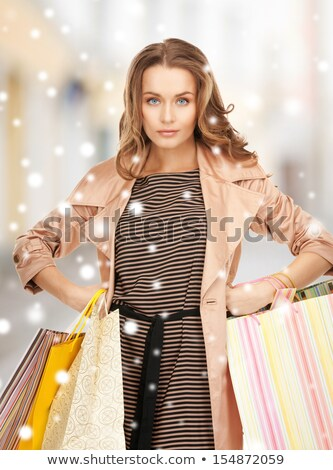 Winter City, People Carrying Presents on Holidays Stock photo © robuart