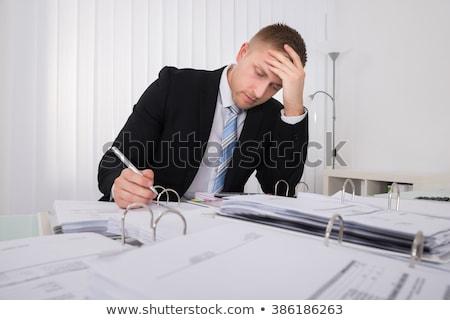 Contador trabalhando tarde escritório sessão Foto stock © AndreyPopov