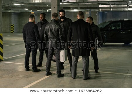 Group of six intercultrual men in black standing in front of each other Stock photo © pressmaster