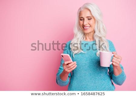 smiling senior woman in blue sweater chilling Stock photo © dolgachov
