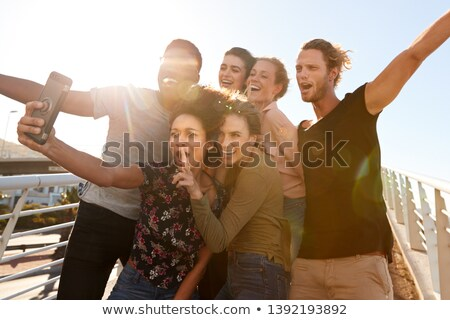group of young people pose on footbridge Stock photo © Paha_L