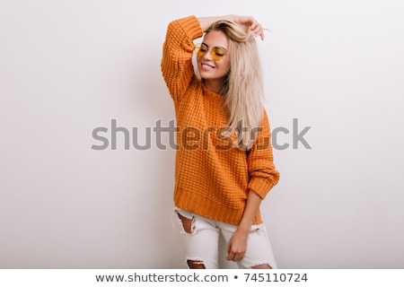 Happy beautiful blonde woman in knitted cardigan Stock photo © darrinhenry