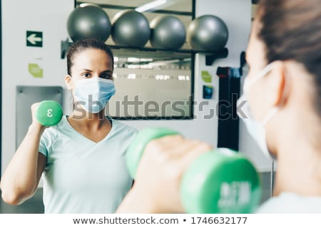 Women at the gym looking in mirror Stock photo © photography33