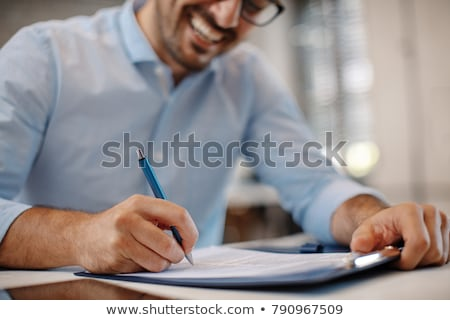 Jeune homme signature document affaires réunion travaux Photo stock © photography33