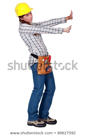 Tradeswoman pushing up against an invisible wall Stock photo © photography33