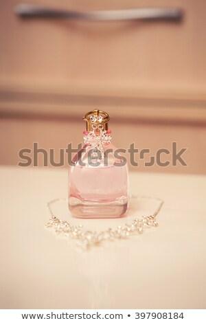 perfume bottles and necklace stock photo © ruzanna
