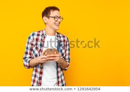 portret · jonge · zakenman · naar · telefoon · geïsoleerd - stockfoto © wavebreak_media