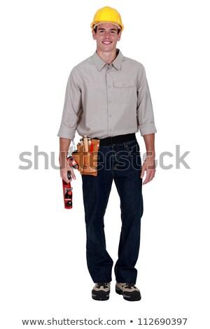 carpenter stood holding wood plane stock photo © photography33