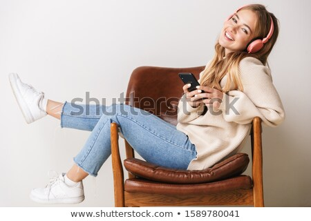 charming young woman using headphones stock photo © pablocalvog