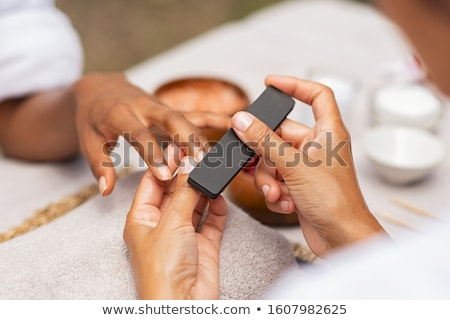 Manicurist filing woman's nails Stock photo © wavebreak_media