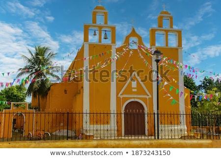 Eski sarı sömürge kilise güzel mavi gökyüzü Stok fotoğraf © jkraft5