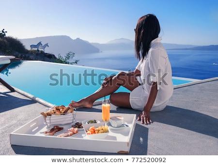 Girlfriends on vacation at swimmingpool Stock photo © phakimata