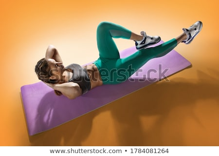 young fitness woman working out stock photo © aikon