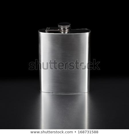 hip flask on black background stock photo © pxhidalgo