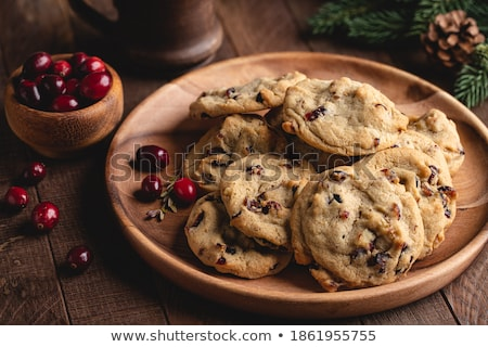 heap of cranberry cookies on wooden plate stock photo © kirill_m