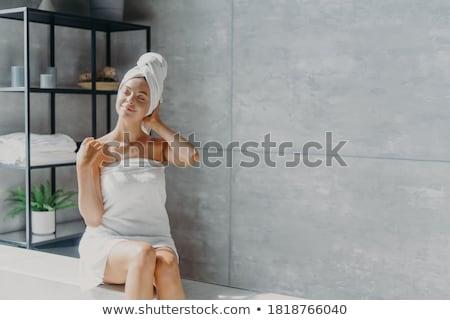 Gyönyörű fiatal nő fürdőkád köntös nagy fehér Stock fotó © dash